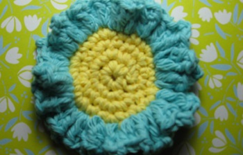 Crochet scrubbies make cute handmade gifts for any occasion. This crochet scrubbie is easy to make using only basic stitches and can be made in under an hour. Experiment with different colors and make an entire set!