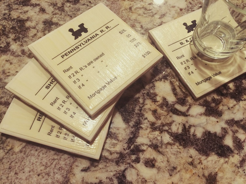 A picture of handmade Monopoly drink coasters.